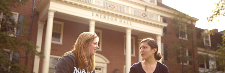 Female students talking in front of Emerson Hall