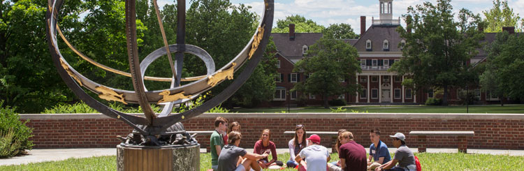 Student gathering in front of MacCracken by sundial